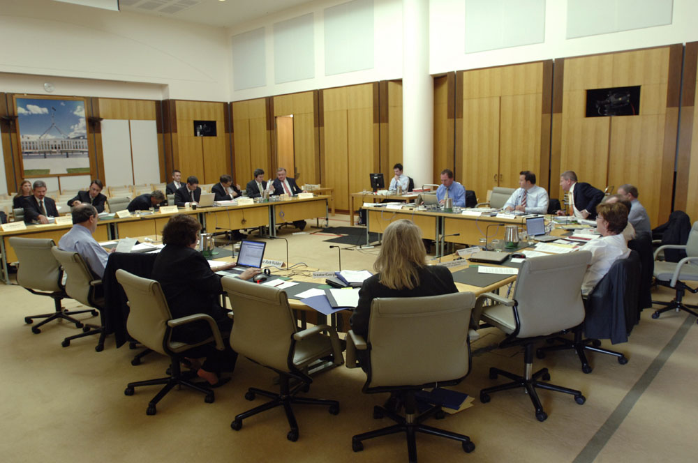 Standing Committee on Economics questioning Senator the Hon Stephen Conroy, Minister representing the Treasurer, and officers from the Macroeconomic Group of the Treasury at an additional estimates hearing, 20 February 2008. Seated facing witnesses clockwise from top: Senators Barnaby Joyce, David Bushby, Mitch Fifield and Alan Eggleston [Deputy Chair] (obscured), John Hawkins [Secretary] (obscured), Senators Annette Hurley [Chair], Helen Coonan, Ruth Webber and Andrew Murray. DPS Auspic.